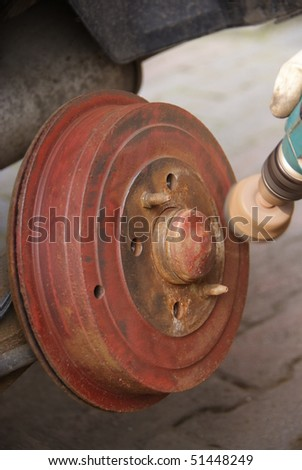 Polishing brake drum - stock photo