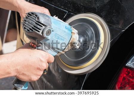 Polishing the car. with power buffer machine - stock photo