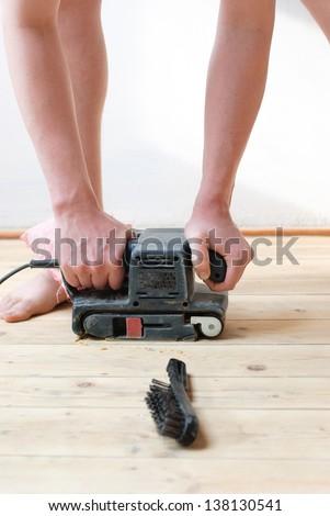 polishing the wood - stock photo