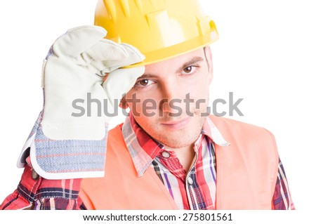 Polite builder geeting by touching his helmet on white background - stock photo