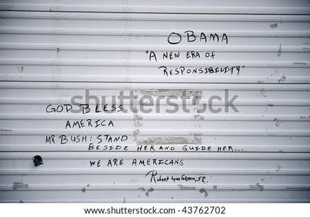 Political graffiti on wall after Hurricane Katrina, New Orleans, Louisiana - stock photo