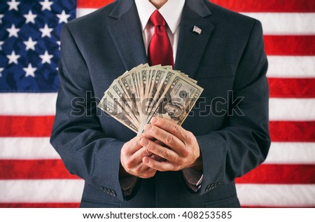 Politician: Man Holding Fanned Out US Currency - stock photo