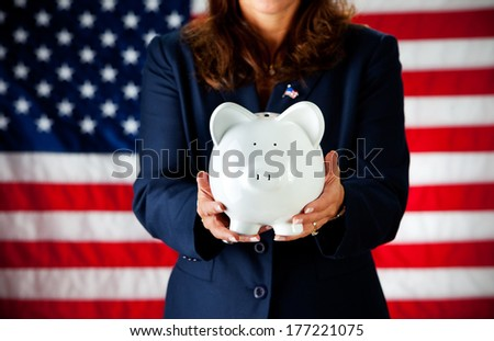 Politician: Woman Holding Piggy Bank