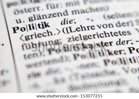Politik, word and explanation from german DUDEN. Shallow depth of field with intent./Politics - stock photo