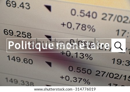 Politique monetaire written in search bar with the financial data visible in the background. Multiple exposure photo. Politique monetaire is Monetary policy on French.