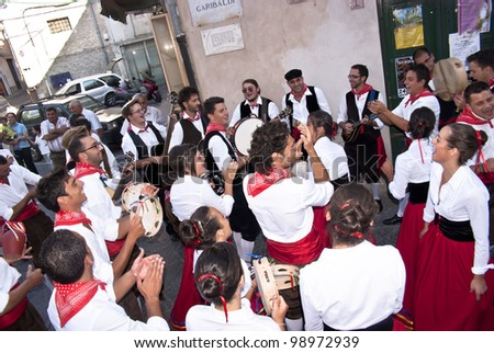 "POLIZZI GENEROSA, SICILY-AUGUST 21:Sicilian folk group from Polizzi G. at the International ""Festival of hazelnuts"",dance and parade through the city: August 21, 2011 in Polizzi Generosa,Sicily, Italy"