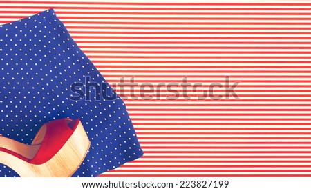 Polka Dot Micro Shorts and Red Wedge Shoe on Striped Background as seen from Above - stock photo