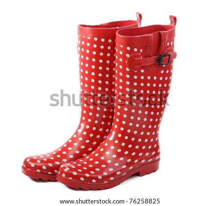Polka dot red rain boots - stock photo