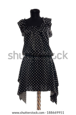 Polka dots dress on mannequin. Woman summer outfit on tailor's dummy isolated on white background.