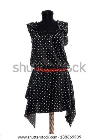 Polka dots dress with red belt on mannequin. Woman summer outfit on tailor's dummy isolated on white background. - stock photo
