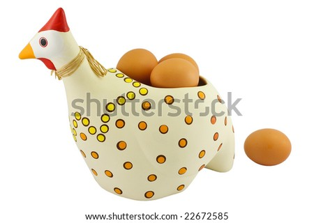 Polka-dotted pottery hen with brown eggs inside isolated on white background