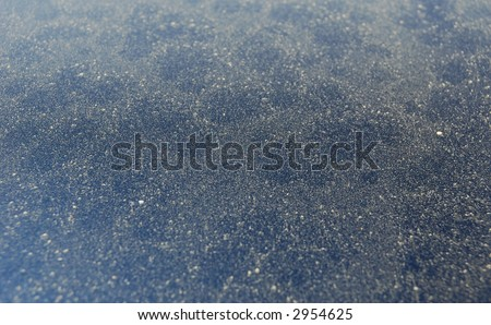 Pollen.  Tree, plant, and grass pollen covering the hood of a car in springtime. - stock photo