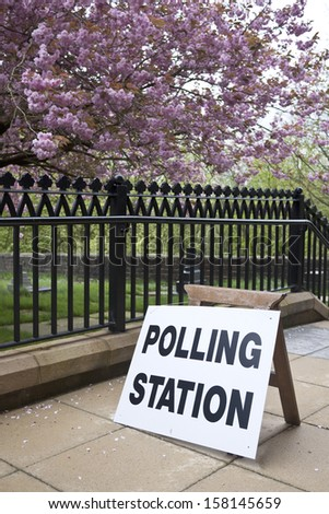 Polling station sign on pavement - stock photo