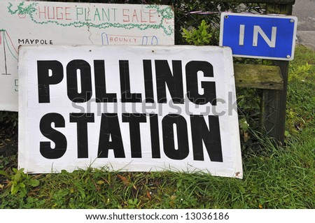 Polling station sign outside of village hall for political elections - stock photo