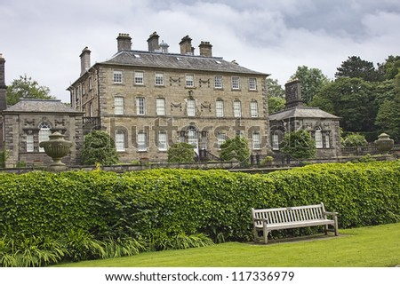 Pollok house with bench in foreground. The house is situated in Pollok Park near Glasgow, Scotland, UK. - stock photo