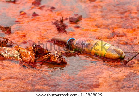 Polluted water flowing after a disaster - stock photo