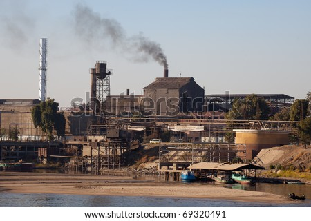 polluting industry on the riverbanks of the Nile