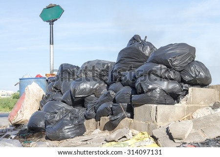 pollution and Disorganized grablage Garbage Disposal and pile of black bags garbage prepare waste disposal, bangkok, thailand - stock photo
