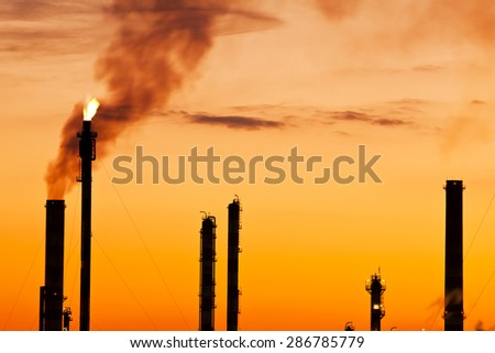 pollution at sunset oil refinery Industry and factories backgrounds - stock photo