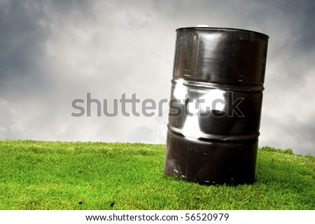 pollution concept using a drum barrel with hazard logo - stock photo