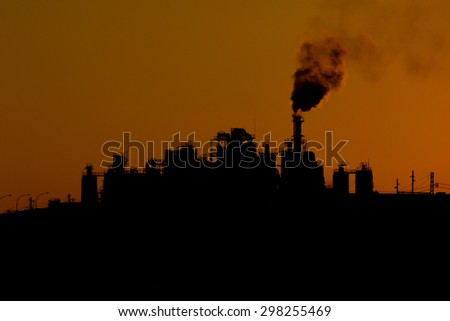 Pollution factory in evening - stock photo