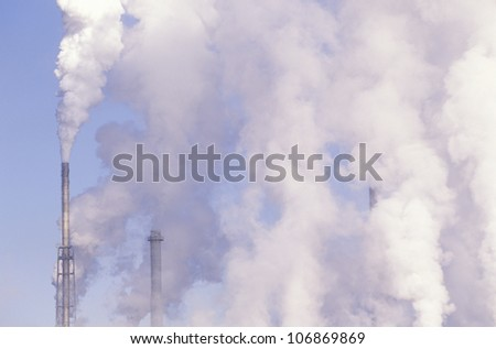 Pollution from smokestacks filling the air at the Boise Cascade Paper Plant in Rumford, Maine