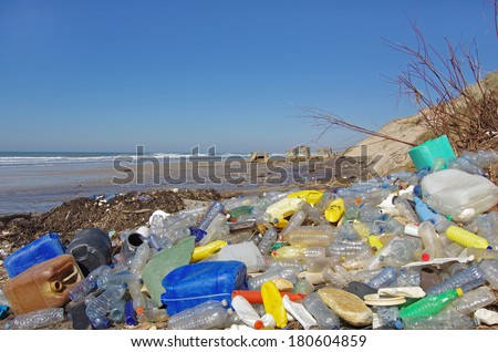 Pollution: garbages, plastic, and wastes on the beach after winter storms - stock photo
