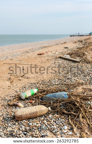 Pollution: garbages, plastic, and wastes on the beach after winter storms. Azov sea. Dolzhanskaya Spit - stock photo