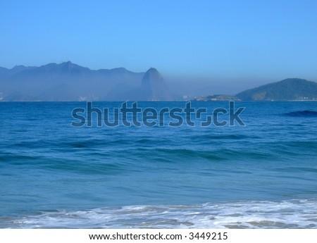 Pollution in Sugar Loaf, Rio de Janeiro seen by Itaipu beach in Niterói, Brazil - stock photo