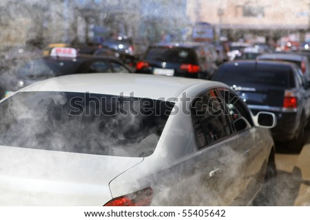 pollution of environment by combustible gas of car - stock photo