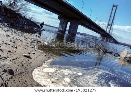 pollution of rivers by sewage in cities - stock photo