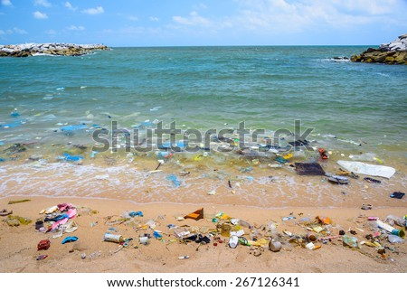 Pollution on the beach of tropical sea. - stock photo