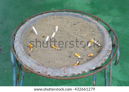 Pollution,Smoking,D anger,Bush, Brown's ashtray filled with garbage lining the gallery.  - stock photo