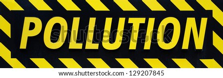 Pollution warning sign of metal (feel free to replace text) - stock photo