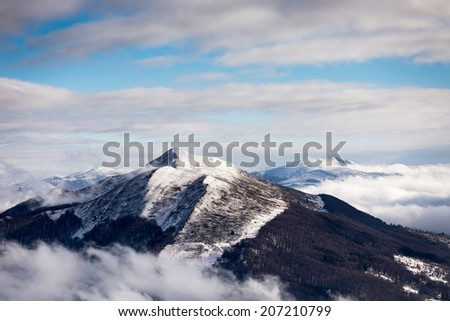 Polonina Wetlinska - winter dramatic clouds over peak - stock photo