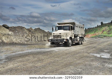 Poltava Region, Ukraine - June 26, 2010: white dump truck on the iron ore opencast