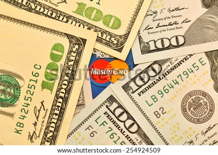 POLTAVA, UKRAINE - JANUARY 24, 2015: Photo Mastercard credit card with USA dollars bills - stock photo