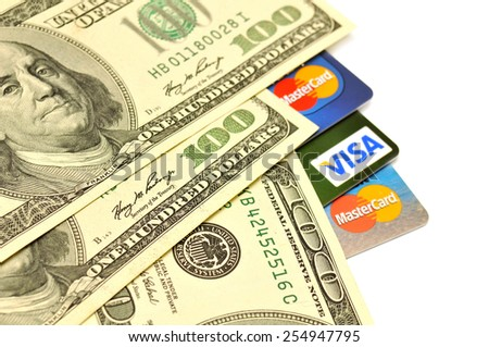 POLTAVA, UKRAINE - JANUARY 24, 2015: Photo of Visa and Mastercard credit card with USA dollars bills isolated on white background - stock photo