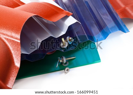 Polycarbonate cover for all sorts of buildings and screws - stock photo