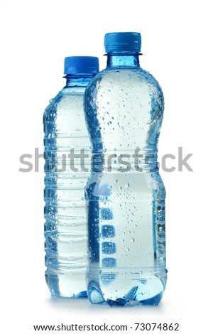 Polycarbonate plastic bottles of mineral water isolated on white background