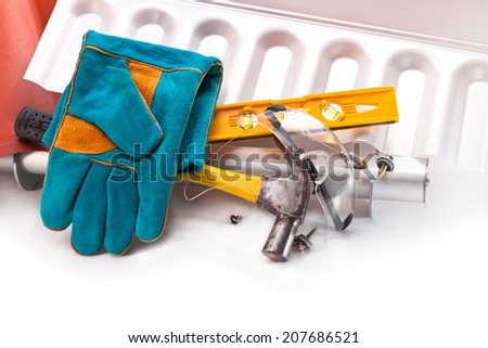 Polycarbonate roof, hammer, level, gloves, screws for mounting on a white background - stock photo