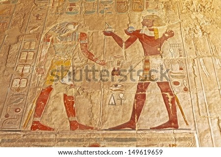 Polychromed carvings of the Pharaoh and God Horus at the awesome Temple of Queen Hatshepsut (1508-1458 BC), between the Valley of Kings and the Valley of Queens, in Luxor (Ancient Thebes), Egypt. - stock photo