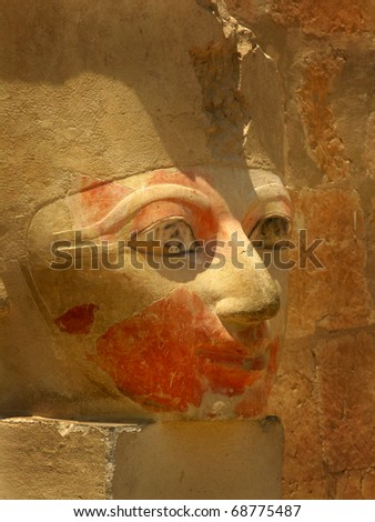 Polychromed head of Queen Hatshepsut (1508-1458 BC) at the awesome Temple of Hatshepsut, between the Valley of Kings and the Valley of Queens, in Luxor (Ancient Thebes), Egypt. - stock photo