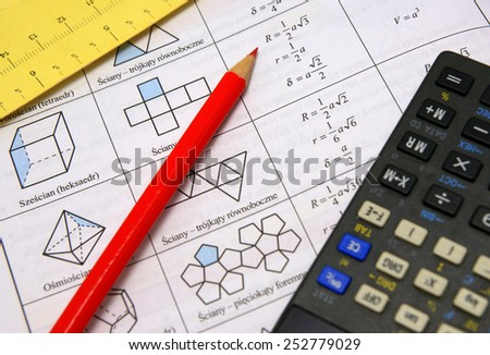Polygons theory illustration: mathematics book, measurement, glasses, calculator and red pencil - stock photo