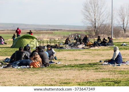 Polykastro, Greece, February 7, 2016: Thousands migrants and refugees are waiting in the parking lot of a gas station in order to cross the borders to FYR of Macedonia