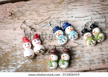 polymeric hand-worked clay jewelry . hristmas red gloves, snowman