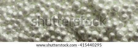 Polystyrene foam beads. Free space - stock photo