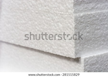 Polystyrene insulation boards background with copyspace and accented sharpness on edges