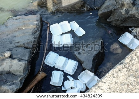 polystyrene waste being dumped into the sea, which will cause pollution - stock photo