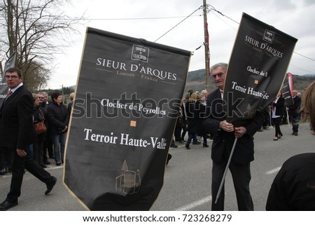 POMAS, FRANCE-MARCH 19, 2016: Parade of disguised people during festival  cap and steeple to celebrate the vineyards of the Aude in Occitanie, France